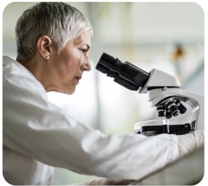 A female doctor while microscoping